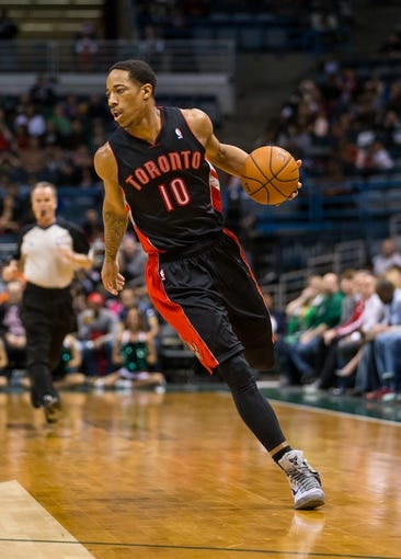 Apr 5, 2014; Milwaukee, WI, USA; Toronto Raptors guard DeMar DeRozan (10) during the game against the Milwaukee Bucks at BMO Harris Bradley Center.  Toronto won 102-98.  Mandatory Credit: Jeff Hanisch-USA TODAY Sports