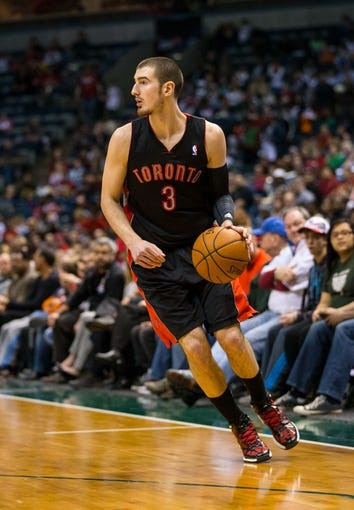 Apr 5, 2014; Milwaukee, WI, USA; Toronto Raptors guard Nando de Colo (3) during the game against the Milwaukee Bucks at BMO Harris Bradley Center.  Toronto won 102-98.  Mandatory Credit: Jeff Hanisch-USA TODAY Sports
