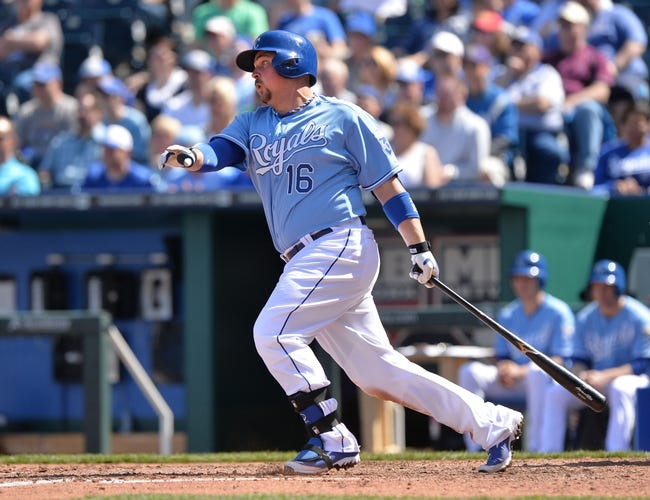Apr 9, 2014; Kansas City, MO, USA; Kansas City Royals designated hitter Billy Butler (16) singles against the Tampa Bay Rays during the fifth inning at Kauffman Stadium. Mandatory Credit: Peter G. Aiken-USA TODAY Sports