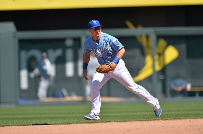 Apr 9, 2014; Kansas City, MO, USA; Kansas City Royals second basemen Johnny Giavotella  (9) gets set on defense against the Tampa Bay Rays during the fifth inning at Kauffman Stadium. Mandatory Credit: Peter G. Aiken-USA TODAY Sports