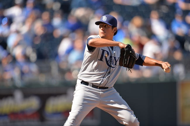 Apr 9, 2014; Kansas City, MO, USA; Tampa Rays pitcher Ceasar Ramos (27) delivers a pitch against the Kansas City Royals during the eighth inning at Kauffman Stadium. Mandatory Credit: Peter G. Aiken-USA TODAY Sports