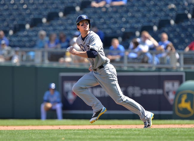 Apr 9, 2014; Kansas City, MO, USA; Tampa Rays base runner Wil Myers (9) takes off on a hit and run against the Kansas City Royals during the second inning at Kauffman Stadium. Mandatory Credit: Peter G. Aiken-USA TODAY Sports