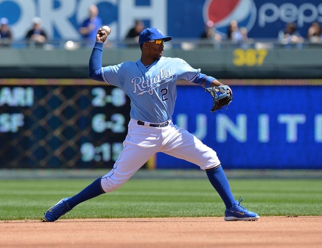 Apr 9, 2014; Kansas City, MO, USA; Kansas City Royals shortstop Alcides Escobar (2) makes a throw to first against the Tampa Bay Rays during the first inning at Kauffman Stadium. Mandatory Credit: Peter G. Aiken-USA TODAY Sports