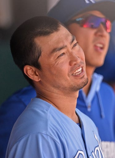 Apr 9, 2014; Kansas City, MO, USA; Kansas City Royals right fielder Nori Aoki (23) in the dugout during the eighth inning against the Tampa Bay Rays at Kauffman Stadium. Mandatory Credit: Peter G. Aiken-USA TODAY Sports
