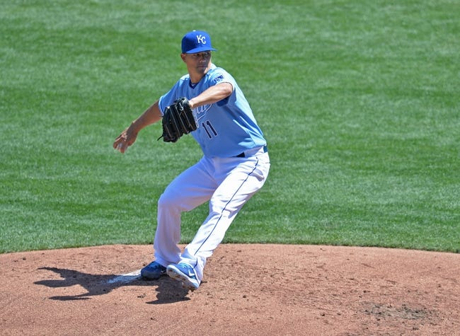 Apr 9, 2014; Kansas City, MO, USA; Kansas City Royals pitcher Jeremy Guthrie (11) delivers a pitch against the Tampa Bay Rays during the third inning at Kauffman Stadium. Mandatory Credit: Peter G. Aiken-USA TODAY Sports