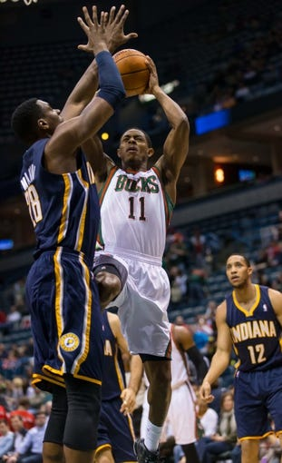Apr 9, 2014; Milwaukee, WI, USA; Milwaukee Bucks guard Brandon Knight (11) during the game against the Indiana Pacers at BMO Harris Bradley Center.  Indiana won 104-102.  Mandatory Credit: Jeff Hanisch-USA TODAY Sports