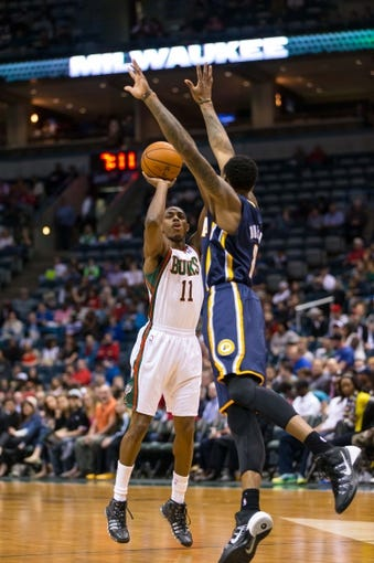 Apr 9, 2014; Milwaukee, WI, USA; Milwaukee Bucks guard Brandon Knight (11) shoots during the game against the Indiana Pacers at BMO Harris Bradley Center.  Indiana won 104-102.  Mandatory Credit: Jeff Hanisch-USA TODAY Sports