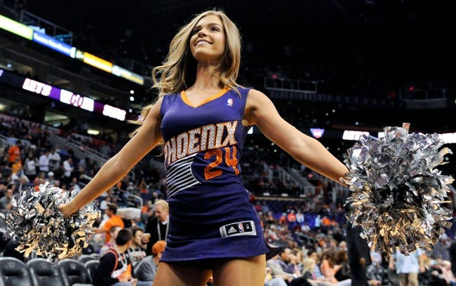 Apr 2, 2014; Phoenix, AZ, USA; A Phoenix Suns dancer performs during the first quarter against the Los Angeles Clippers at US Airways Center. The Clippers won 112-108. Mandatory Credit: Casey Sapio-USA TODAY Sports
