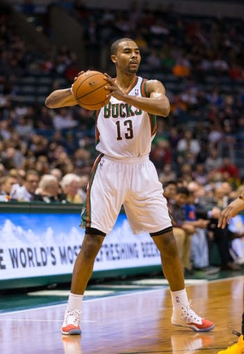 Apr 9, 2014; Milwaukee, WI, USA; Milwaukee Bucks guard Ramon Sessions (13) during the game against the Indiana Pacers at BMO Harris Bradley Center.  Indiana won 104-102.  Mandatory Credit: Jeff Hanisch-USA TODAY Sports