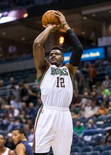 Apr 9, 2014; Milwaukee, WI, USA; Milwaukee Bucks forward Jeff Adrien (12) shoots during the game against the Indiana Pacers at BMO Harris Bradley Center.  Indiana won 104-102.  Mandatory Credit: Jeff Hanisch-USA TODAY Sports