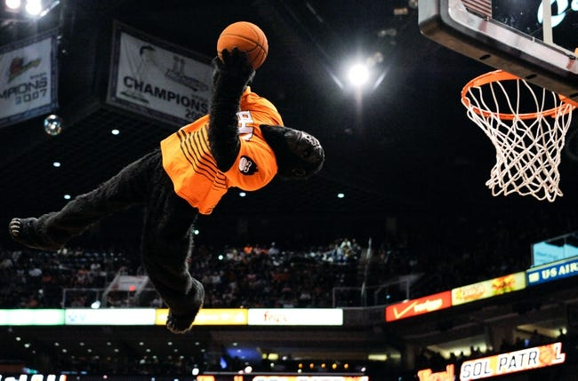 Apr 2, 2014; Phoenix, AZ, USA; The Phoenix Suns mascot the Gorilla dunks the ball during a timeout during the fourth quarter against the Los Angeles Clippers at US Airways Center. The Clippers won 112-108. Mandatory Credit: Casey Sapio-USA TODAY Sports