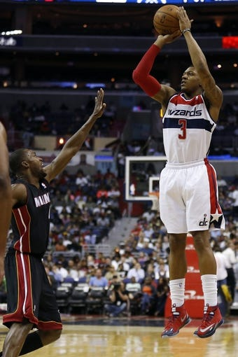 Apr 14, 2014; Washington, DC, USA; Washington Wizards guard Bradley Beal (3) shoots the ball over Miami Heat guard Toney Douglas (0) in the first quarter at Verizon Center. Mandatory Credit: Geoff Burke-USA TODAY Sports