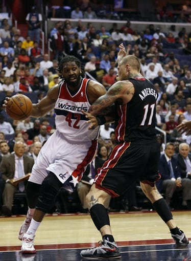 Apr 14, 2014; Washington, DC, USA; Washington Wizards forward Nene (42) dribbles the ball as Miami Heat forward Chris Andersen (11) defends in the second quarter at Verizon Center. Mandatory Credit: Geoff Burke-USA TODAY Sports