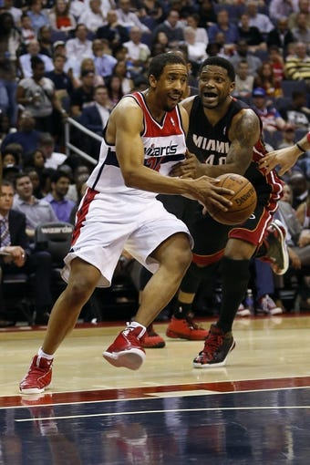 Apr 14, 2014; Washington, DC, USA; Washington Wizards guard Andre Miller (24) dribbles the ball past Miami Heat forward Udonis Haslem (40) in the second quarter at Verizon Center. Mandatory Credit: Geoff Burke-USA TODAY Sports