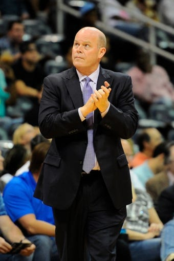 Apr 14, 2014; Atlanta, GA, USA; Charlotte Bobcats head coach Steve Clifford reacts against the Atlanta Hawks during the first half at Philips Arena. Mandatory Credit: Dale Zanine-USA TODAY Sports