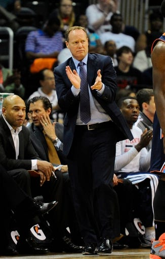 Apr 14, 2014; Atlanta, GA, USA; Atlanta Hawks head coach Mike Budenholzer reacts against the Charlotte Bobcats during the first half at Philips Arena. Mandatory Credit: Dale Zanine-USA TODAY Sports