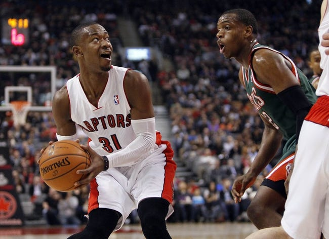 Apr 14, 2014; Toronto, Ontario, CAN; Toronto Raptors guard Terrence Ross (31) goes to pass as Milwaukee Bucks forward Khris Middleton (22) defends during the first half at the Air Canada Centre. Mandatory Credit: John E. Sokolowski-USA TODAY Sports