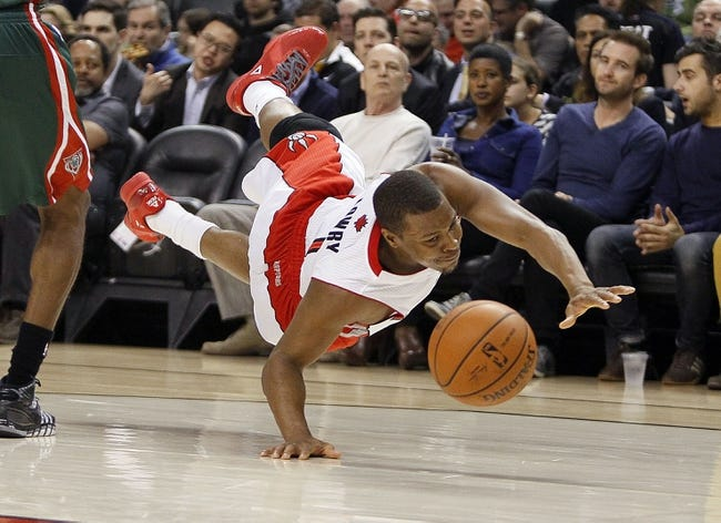Apr 14, 2014; Toronto, Ontario, CAN; Toronto Raptors guard Kyle Lowry (7) dives for a ball against the Milwaukee Bucks during the first half at the Air Canada Centre. Mandatory Credit: John E. Sokolowski-USA TODAY Sports
