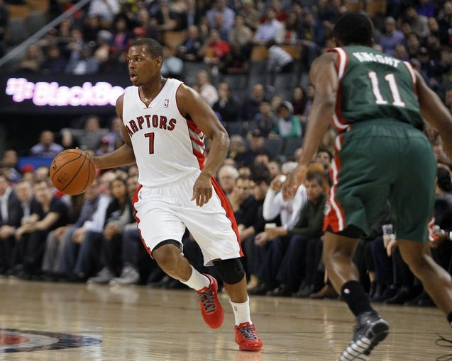 Apr 14, 2014; Toronto, Ontario, CAN; Toronto Raptors guard Kyle Lowry (7) carries the ball against Milwaukee Bucks guard Brandon Knight (11) during the first half at the Air Canada Centre. Mandatory Credit: John E. Sokolowski-USA TODAY Sports