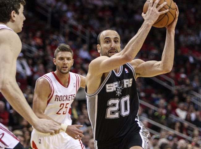Apr 14, 2014; Houston, TX, USA; San Antonio Spurs guard Manu Ginobili (20) drives to the basket during the first quarter against the Houston Rockets at Toyota Center. Mandatory Credit: Troy Taormina-USA TODAY Sports