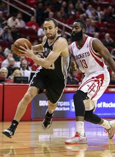 Apr 14, 2014; Houston, TX, USA; San Antonio Spurs guard Manu Ginobili (20) attempts to drive the ball past Houston Rockets guard James Harden (13) during the first quarter at Toyota Center. Mandatory Credit: Troy Taormina-USA TODAY Sports