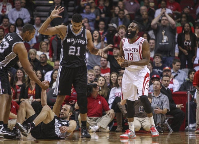 Apr 14, 2014; Houston, TX, USA; Houston Rockets guard James Harden (13) reacts after a call during the second quarter against the San Antonio Spurs at Toyota Center. Mandatory Credit: Troy Taormina-USA TODAY Sports