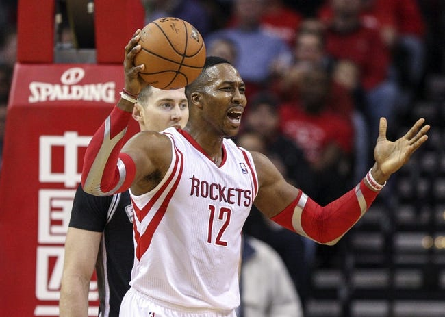 Apr 14, 2014; Houston, TX, USA; Houston Rockets center Dwight Howard (12) reacts after a call during the second quarter against the San Antonio Spurs at Toyota Center. Mandatory Credit: Troy Taormina-USA TODAY Sports