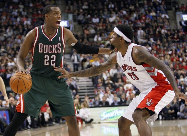Apr 14, 2014; Toronto, Ontario, CAN; Milwaukee Bucks forward Khris Middleton (22) calls to his teammates as he fends off Toronto Raptors guard-forward John Salmons (25) at the Air Canada Centre. Toronto defeated Milwaukee 110-100. Mandatory Credit: John E. Sokolowski-USA TODAY Sports
