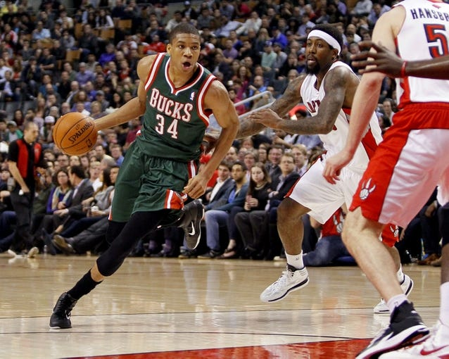 Apr 14, 2014; Toronto, Ontario, CAN; Milwaukee Bucks guard-forward Giannis Antetokounmpo (34) drives to the net against Toronto Raptors guard-forward John Salmons (25) at the Air Canada Centre. Toronto defeated Milwaukee 110-100. Mandatory Credit: John E. Sokolowski-USA TODAY Sports