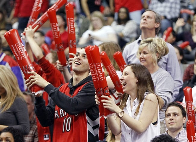 Apr 14, 2014; Toronto, Ontario, CAN; Toronto Raptors fans during a break in the action against the Milwaukee Bucks at the Air Canada Centre. Toronto defeated Milwaukee 110-100. Mandatory Credit: John E. Sokolowski-USA TODAY Sports