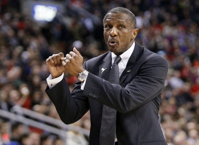 Apr 14, 2014; Toronto, Ontario, CAN; Toronto Raptors head coach Dwane Casey signals in a play at the Air Canada Centre against the Milwaukee Bucks. Toronto defeated Milwaukee 110-100. Mandatory Credit: John E. Sokolowski-USA TODAY Sports