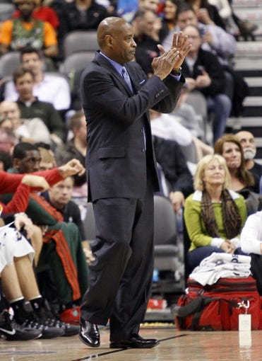 Apr 14, 2014; Toronto, Ontario, CAN; Milwaukee Bucks head coach Larry Drew signals to his players at the Air Canada Centre against the Toronto Raptors. Toronto defeated Milwaukee 110-100. Mandatory Credit: John E. Sokolowski-USA TODAY Sports