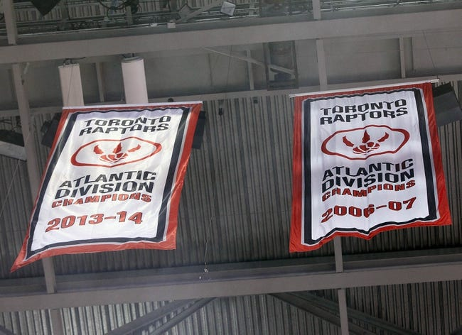Apr 14, 2014; Toronto, Ontario, CAN; Toronto Raptors unveil the division banner prior to a game against the Milwaukee Bucks at the Air Canada Centre. Toronto defeated Milwaukee 110-100. Mandatory Credit: John E. Sokolowski-USA TODAY Sports