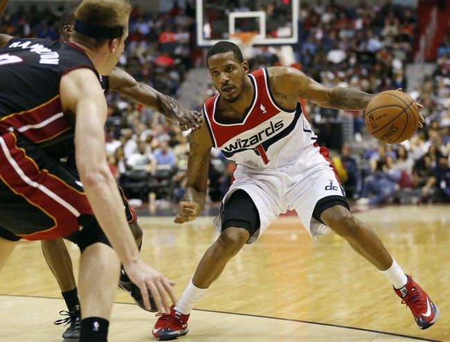 Apr 14, 2014; Washington, DC, USA; Washington Wizards forward Trevor Ariza (1) dribbles the ball as Miami Heat center Justin Hamilton (7) defends in the second quarter at Verizon Center. The Wizards won 114-93. Mandatory Credit: Geoff Burke-USA TODAY Sports