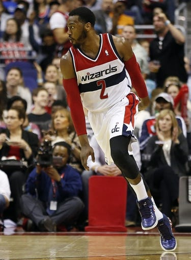 Apr 14, 2014; Washington, DC, USA; Washington Wizards guard John Wall (2) celebrates after scoring against the Miami Heat in the third quarter at Verizon Center. The Wizards won 114-93. Mandatory Credit: Geoff Burke-USA TODAY Sports