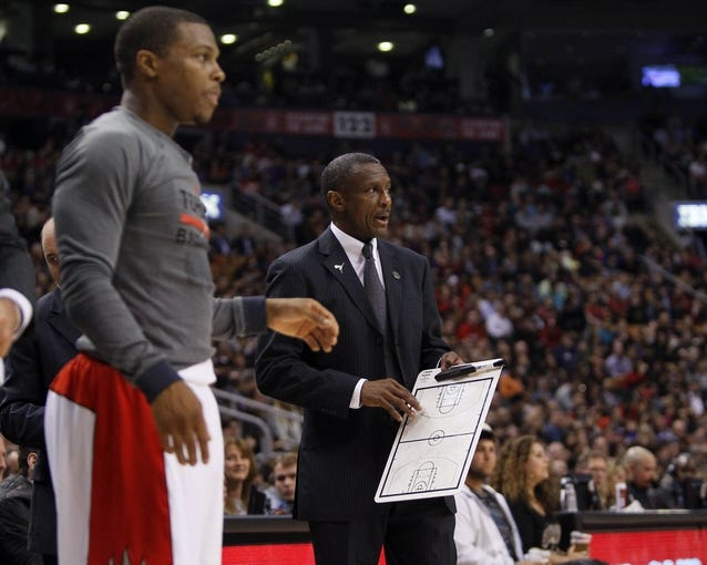 Apr 14, 2014; Toronto, Ontario, CAN; Toronto Raptors guard Kyle Lowry (left) and Toronto Raptors head coach Dwane Casey during a break against the Milwaukee Bucks at the Air Canada Centre. Toronto defeated Milwaukee 110-100. Mandatory Credit: John E. Sokolowski-USA TODAY Sports