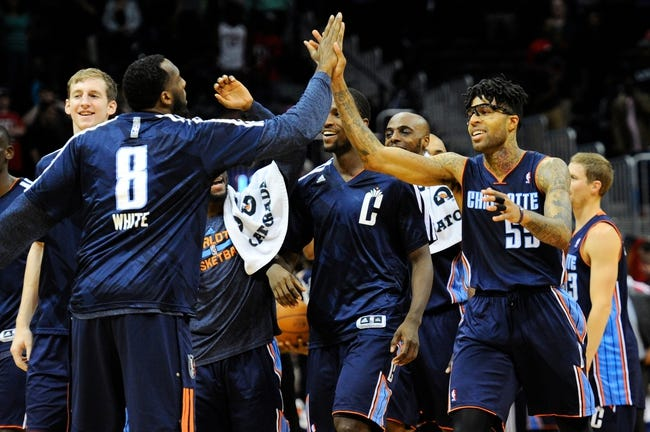 Apr 14, 2014; Atlanta, GA, USA; Charlotte Bobcats guard Chris Douglas-Roberts (55) reacts with team mates after making a last second basket to win the game against the Atlanta Hawks during the second half at Philips Arena. The Bobcats defeated the Hawks 95-93. Mandatory Credit: Dale Zanine-USA TODAY Sports
