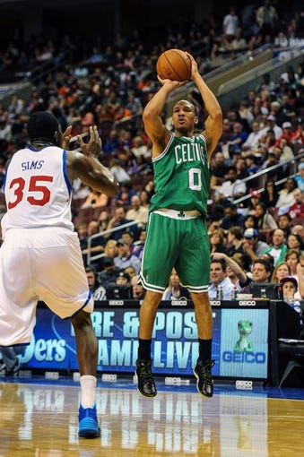 Apr 14, 2014; Philadelphia, PA, USA; Boston Celtics guard Avery Bradley (0) takes a shot during the second quarter of the game against the Philadelphia 76ers at Wells Fargo Center. The Philadelphia 76ers won 113-108. Mandatory Credit: John Geliebter-USA TODAY Sports