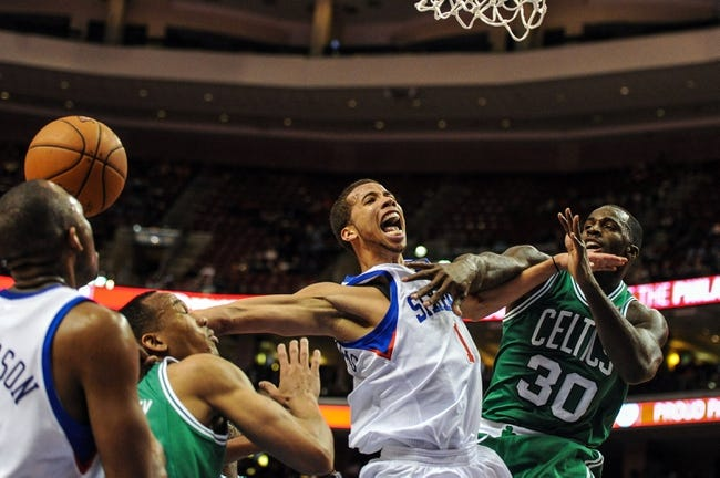 Apr 14, 2014; Philadelphia, PA, USA; Philadelphia 76ers guard Michael Carter-Williams (1) is fouled by Boston Celtics forward Brandon Bass (30) during the third quarter of the game at Wells Fargo Center. The Philadelphia 76ers won 113-108. Mandatory Credit: John Geliebter-USA TODAY Sports