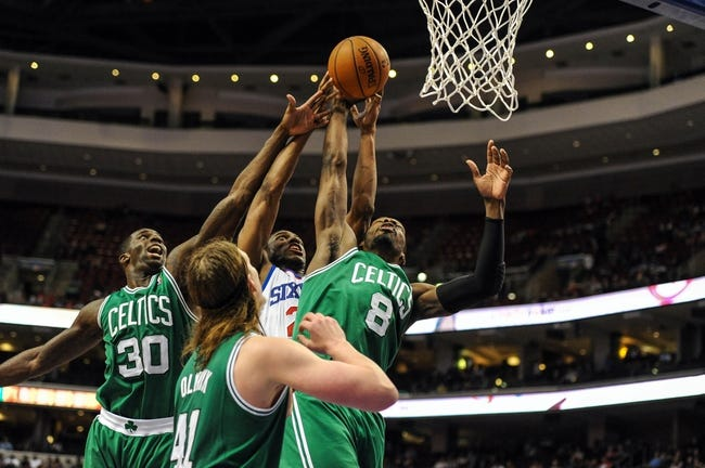 Apr 14, 2014; Philadelphia, PA, USA; Philadelphia 76ers forward Thaddeus Young (21) and Boston Celtics forward Jeff Green (8) battle for a rebound during the third quarter of the game at Wells Fargo Center. Mandatory Credit: John Geliebter-USA TODAY Sports