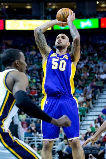 Apr 14, 2014; Salt Lake City, UT, USA; Los Angeles Lakers center Robert Sacre (50) shoots during the first half against the Utah Jazz at EnergySolutions Arena. Mandatory Credit: Russ Isabella-USA TODAY Sports