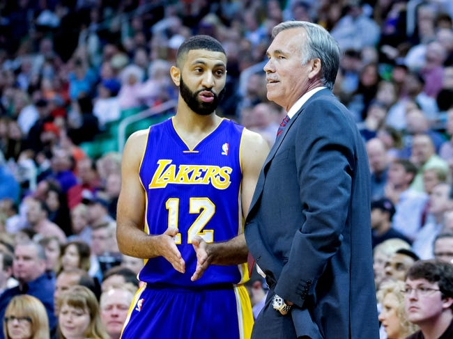 Apr 14, 2014; Salt Lake City, UT, USA; Los Angeles Lakers guard Kendall Marshall (12) talks with head coach Mike D'Antoni during the first half against the Utah Jazz at EnergySolutions Arena. Mandatory Credit: Russ Isabella-USA TODAY Sports