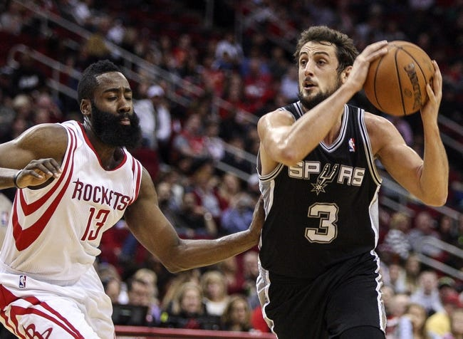 Apr 14, 2014; Houston, TX, USA; San Antonio Spurs guard Marco Belinelli (3) drives the ball to the basket during the first quarter against the Houston Rockets at Toyota Center. Mandatory Credit: Troy Taormina-USA TODAY Sports