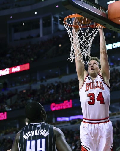 Apr 14, 2014; Chicago, IL, USA; Chicago Bulls forward Mike Dunleavy (34) dunks the ball against Orlando Magic forward Andrew Nicholson (44) during the second half at the United Center. Chicago defeats Orlando 108-95. Mandatory Credit: Mike DiNovo-USA TODAY Sports