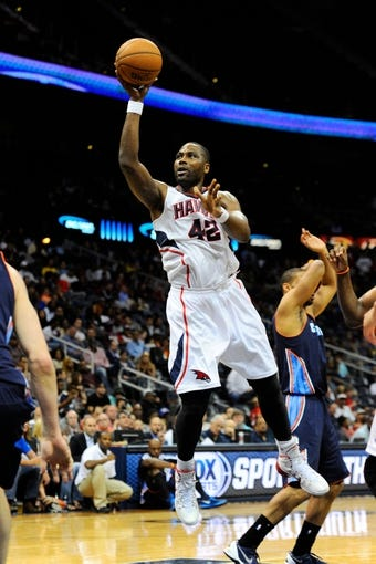 Apr 14, 2014; Atlanta, GA, USA; Atlanta Hawks forward Elton Brand (42) shoots against the Charlotte Bobcats during the second half at Philips Arena. The Bobcats defeated the Hawks 95-93. Mandatory Credit: Dale Zanine-USA TODAY Sports