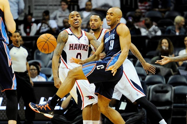 Apr 14, 2014; Atlanta, GA, USA; Charlotte Bobcats guard Gerald Henderson (9) reacts to losing the ball to Atlanta Hawks guard Jeff Teague (0) during the second half at Philips Arena. The Bobcats defeated the Hawks 95-93. Mandatory Credit: Dale Zanine-USA TODAY Sports