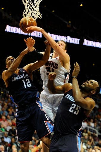 Apr 14, 2014; Atlanta, GA, USA; Atlanta Hawks center Mike Muscala (31) fights for a rebound with Charlotte Bobcats guard Gary Neal (12) and center Al Jefferson (25) during the second half at Philips Arena. The Bobcats defeated the Hawks 95-93. Mandatory Credit: Dale Zanine-USA TODAY Sports
