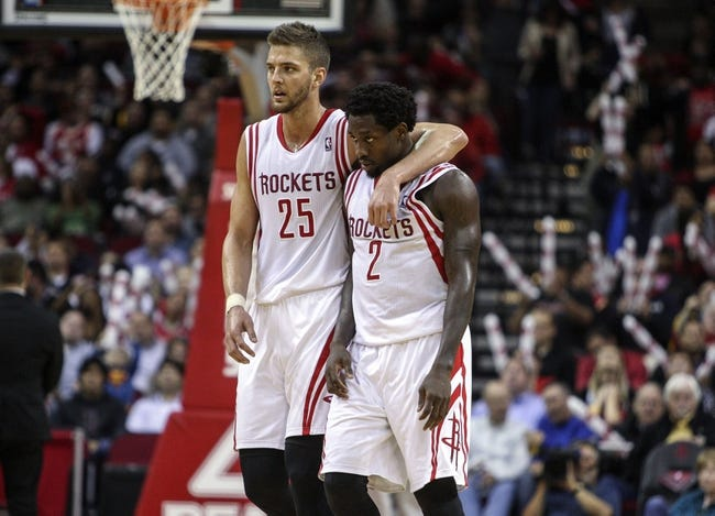 Apr 14, 2014; Houston, TX, USA; Houston Rockets forward Chandler Parsons (25) and guard Patrick Beverley (2) react after a play during the third quarter against the San Antonio Spurs at Toyota Center. The Rockets defeated the Spurs 104-98. Mandatory Credit: Troy Taormina-USA TODAY Sports