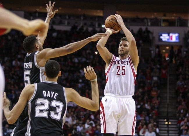 Apr 14, 2014; Houston, TX, USA; Houston Rockets forward Chandler Parsons (25) shoots during the fourth quarter against the San Antonio Spurs at Toyota Center. The Rockets defeated the Spurs 104-98. Mandatory Credit: Troy Taormina-USA TODAY Sports