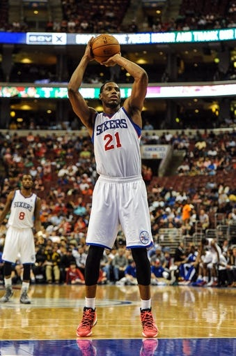 Apr 14, 2014; Philadelphia, PA, USA; Philadelphia 76ers forward Thaddeus Young (21) shoots from the foul line during third quarter of the game against the Boston Celtics  at Wells Fargo Center. The Philadelphia 76ers won 113-108. Mandatory Credit: John Geliebter-USA TODAY Sports